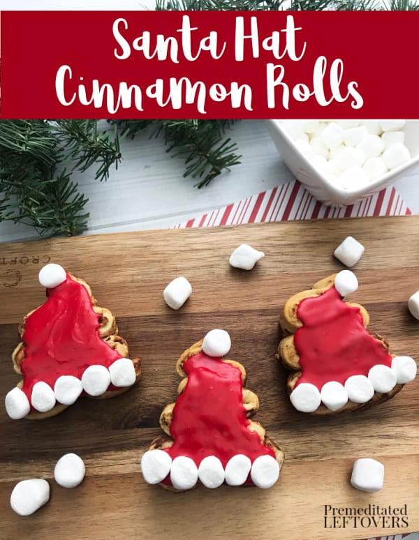 Surprise the family with a Christmas breakfast with these adorable Santa Hat Cinnamon rolls. Quick & easy recipe using refrigerated dough.
