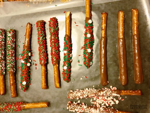 christmas pretzel rods on wax paper