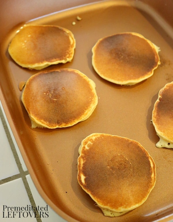 grain-free pancakes that are almost finished cooking on the griddle