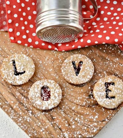 Your sweetheart will love this darling Valentine's Cut Out Cookies Recipe. Send a special message this year in the form of a tasty cookie filled with jam.