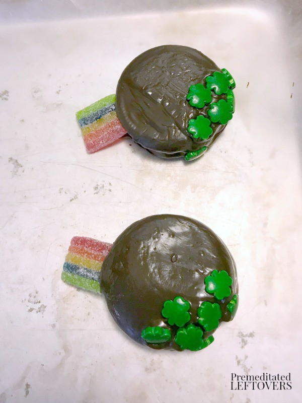 adding candy to pot of gold oreos