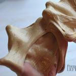 golden slime stretched over hands