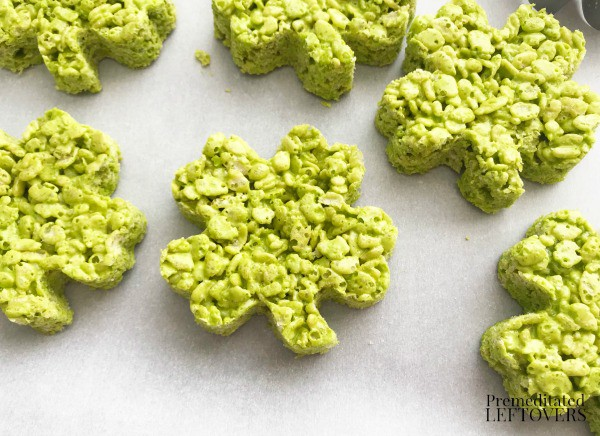 green shamrock rice krispie treats on waxed paper