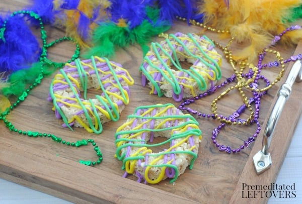 king cake mardi gras rice krispie treats on a tray