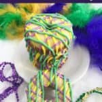 Mardi Gras cake mix donuts on plate with beads