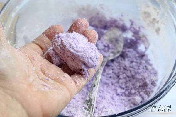 Adding water to ingredients for Mermaid Bath Bomb Recipe