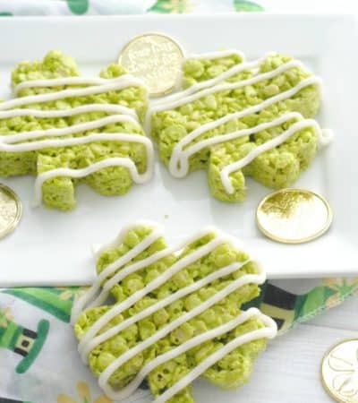 shamrock rice krispie treats on platter with gold coins