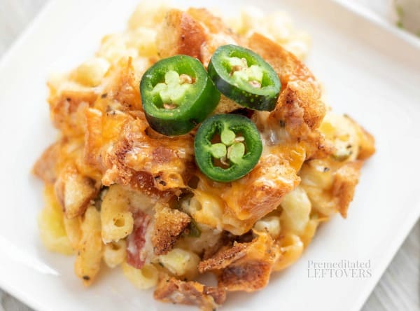 Creamy Jalapeño Popper Macaroni and Cheese Recipe plated and topped with sliced jalapeno peppers.
