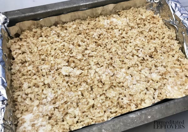 Press Rice Krispie Treats into a 9 x 13 pan then refrigerate for 30 minutes.