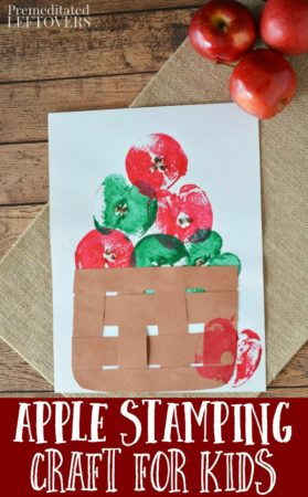 apple stamping craft for kids on white paper with a woven paper basket