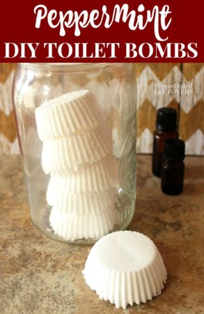 A mason jar of homemade peppermint toilet bombs made with essential oils.