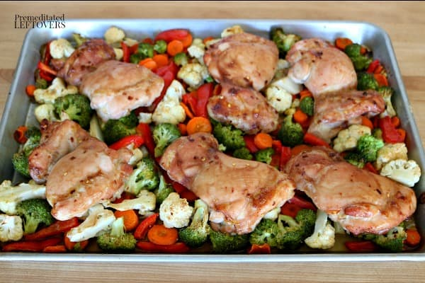 Oven cooked Mongolian chicken thighs and vegetables on a baking sheet pan. Easy sheet pan chicken recipe!