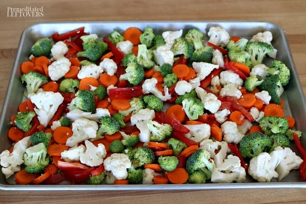 The chopped vegetables on the sheet pan.