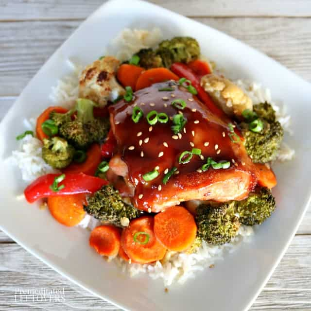 Quick and easy sheet pan Mongolian chicken recipe with vegetables served over rice.