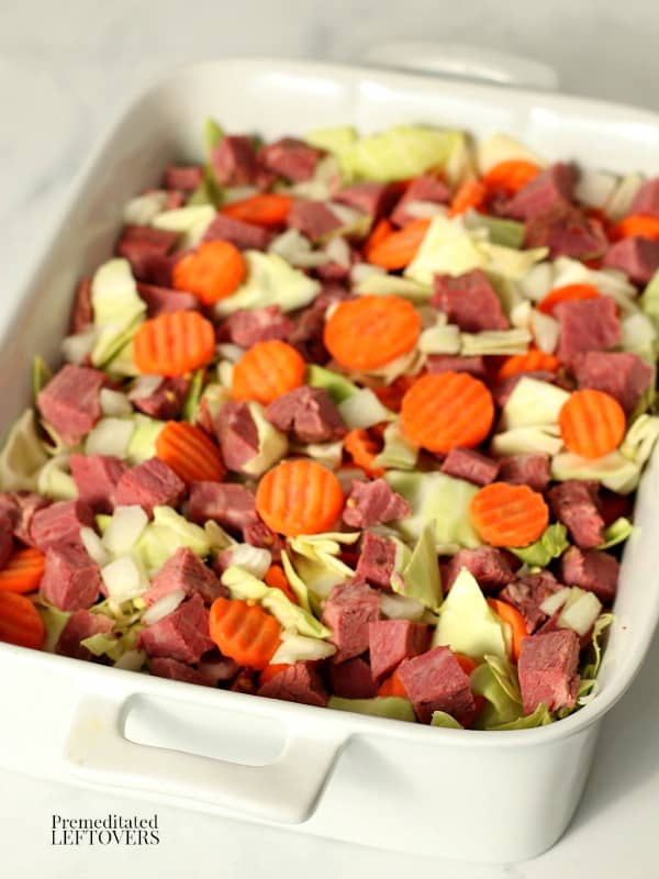 Add the diced corned beef, cabbage, and carrots to a casserole dish.