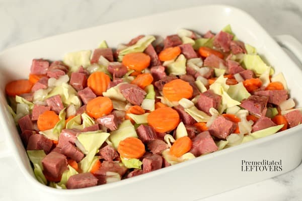 Drizzle the gravy over the corned beef and vegetables.