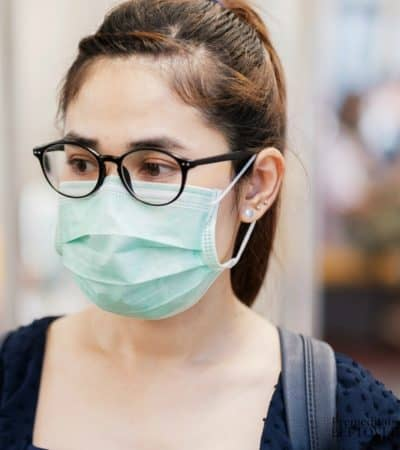 A lady with fog-free glasses and a face mask.