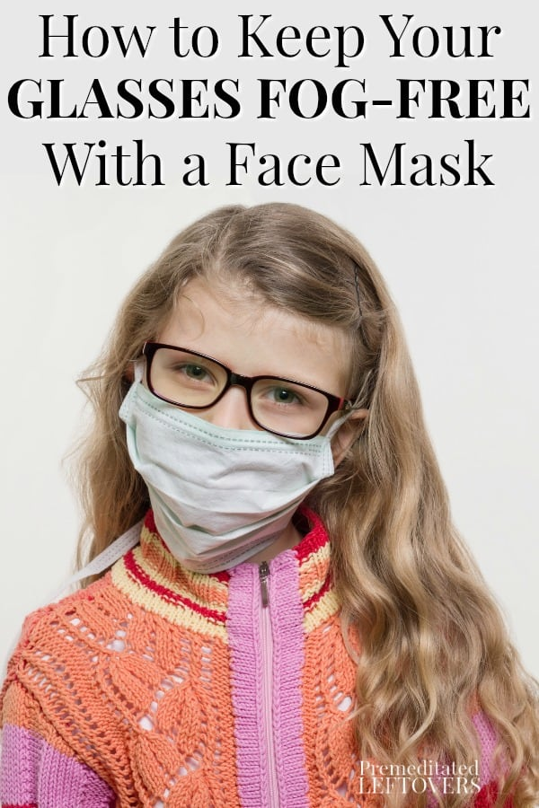 Girl child wearing a face mask and glasses.
