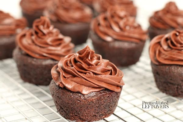 Fluffy chocolate crisco frosting on chocolate cupcakes.