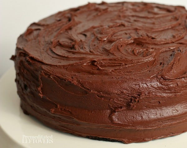 A homemade chocolate depression cake recipe frosted with chocolate icing.