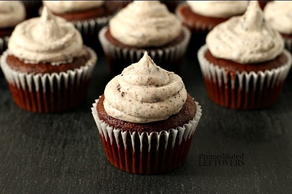 Homemade cookies and cream frosting on chocolate cupcakes.