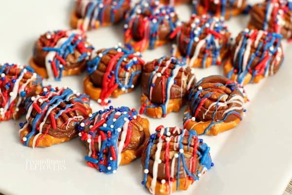 a serving dish with patriotic Rolo pretzel turtles on it