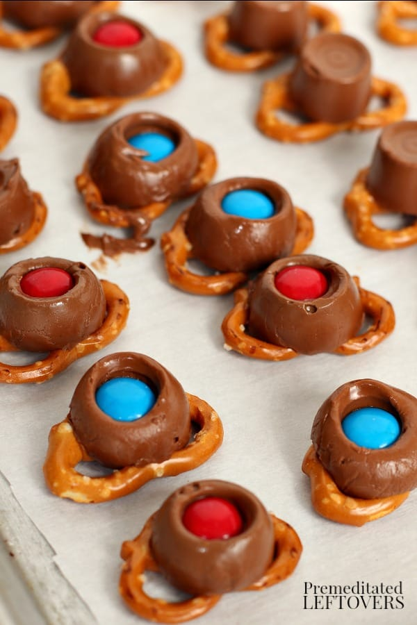 M&Ms pressed into melted Rolos sitting on pretzels