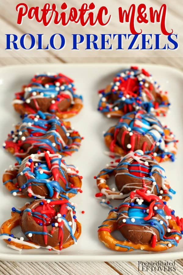 Red, white, and blue patriotic m&m rolo pretzels on a plate.