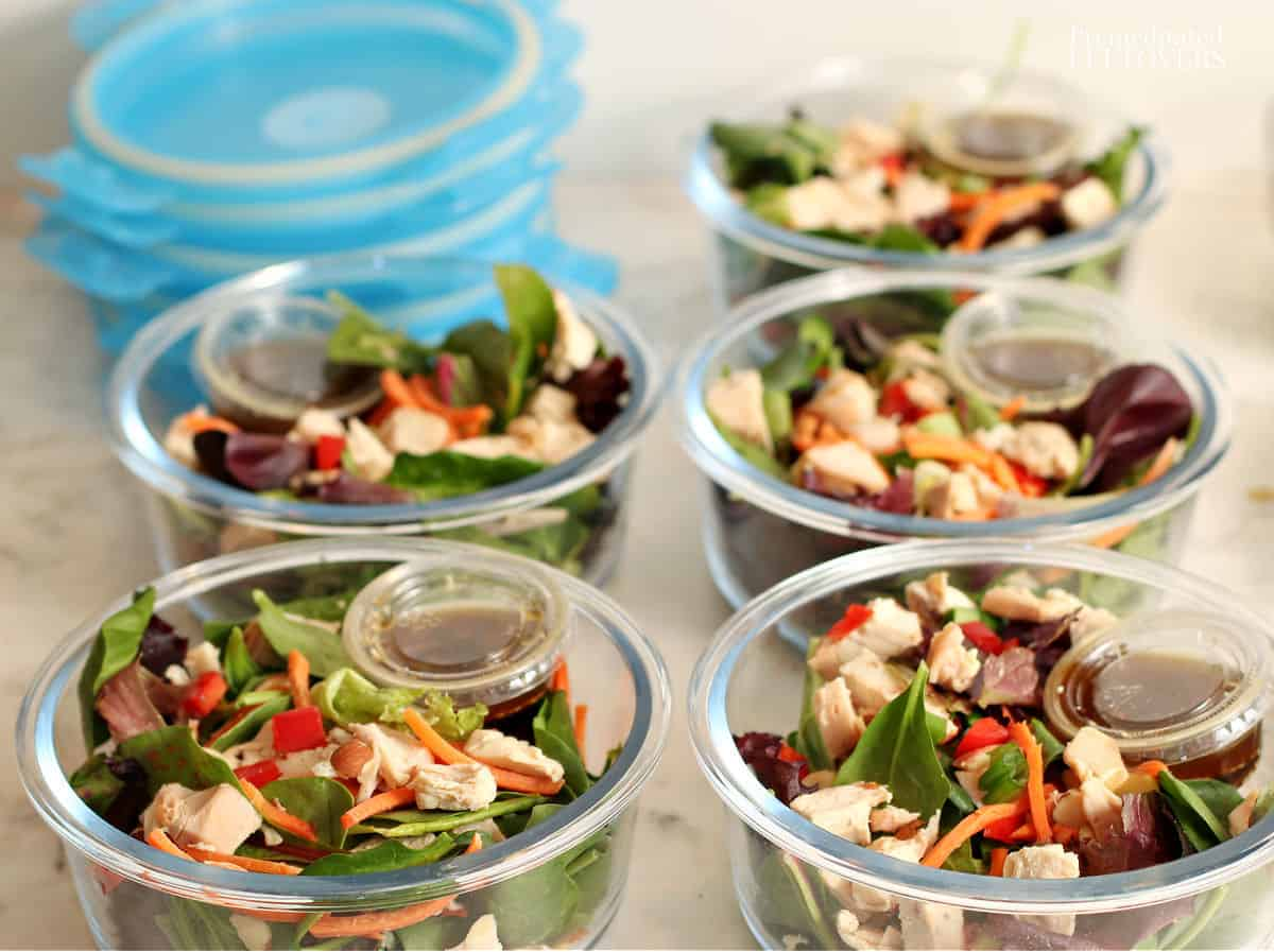 5 meal prep Asian chicken salads in glass containers