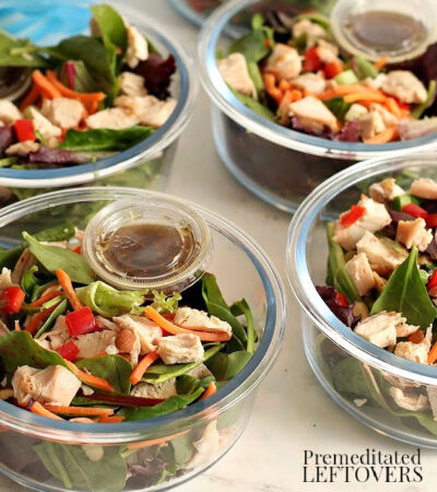 Asian chicken salads in meal prep bowls with Asian dressing