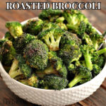 roasted broccoli in a white bowl