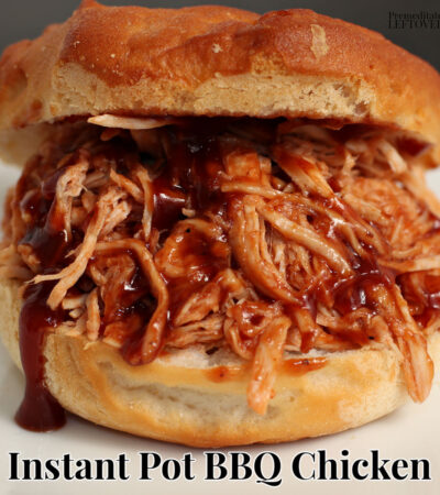 Quick and easy instant pot bbq chicken on a hamburger bun with barbecue sauce dripping off the shredded chicken.