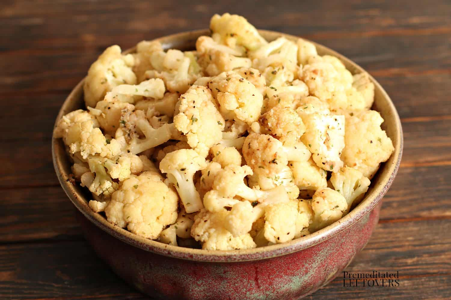 roasted cauliflower in a red bowl