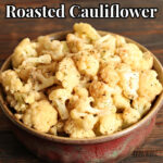 roasted cauliflower with spices in a red bowl